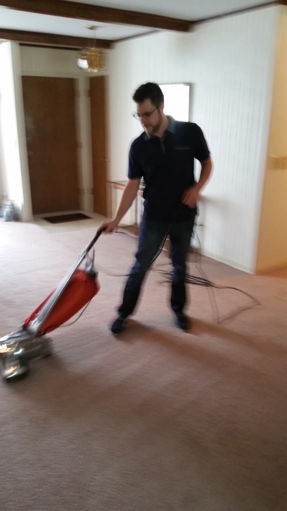Houston vacuuming with his Omega